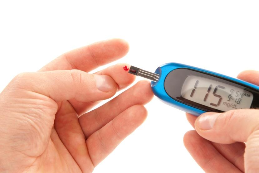 Diabetic patient doing glucose level blood test
