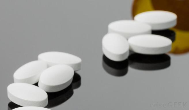 white-tablet-pills-on-reflective-surface